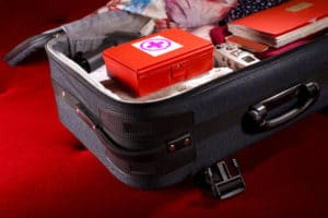 Suitcase with first-aid kit for Travel Health