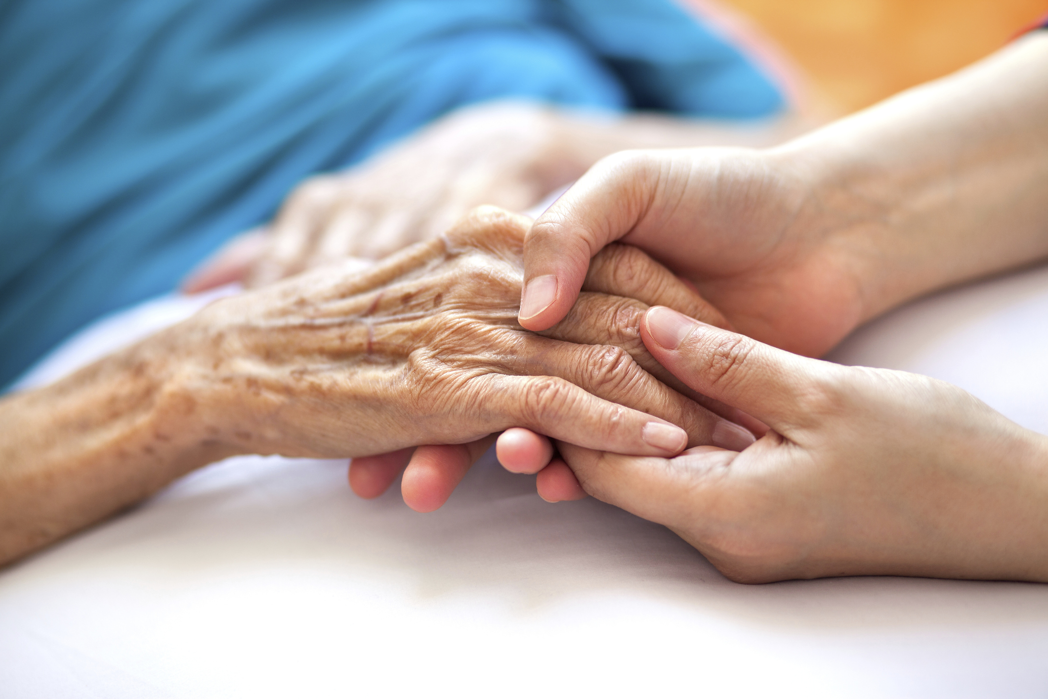 doctor examines a patient's hand with osteoarthritis
