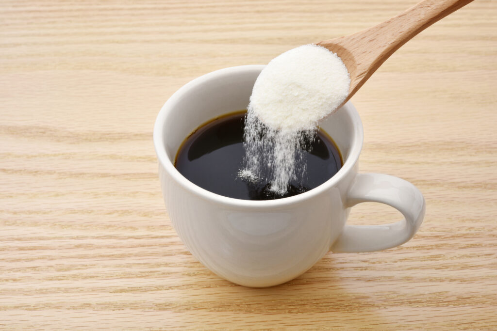collagen being poured into a cup of coffee as an arthritis management technique