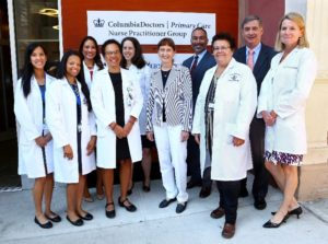 Image of nurse practitioners and executives at the opening of the Washington Heights Nurse Practitioner Group facility.